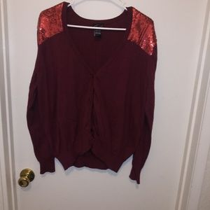 Red sweater with red sequence shoulders